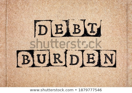 Debt word made by letter pieces  Stock photo © fuzzbones0