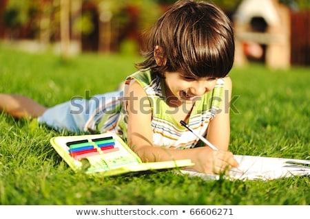 ребенка чтение молодые Живопись играет цветы Сток-фото © jeancliclac