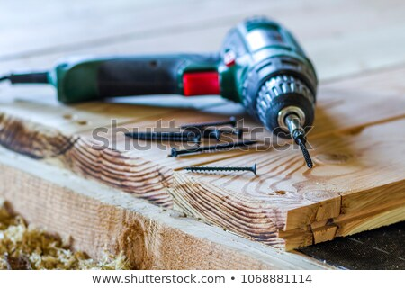 Screw and electric screwdriver stock photo © jordanrusev