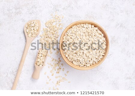Healthy eating oat flakes closeup on a stone background Stock photo © mcherevan