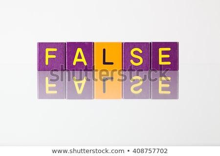 False  - an inscription from children's blocks Stock photo © CaptureLight