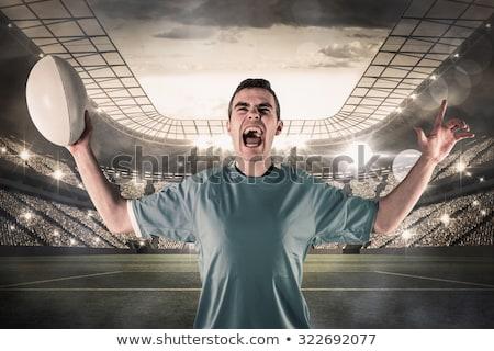 Excited rugby player gesturing victory Stock photo © wavebreak_media