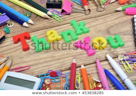 thank you word and office tools on wooden table stock photo © fuzzbones0