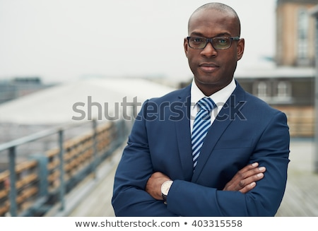 Serious handsome man with arms folded standing Stock photo © deandrobot