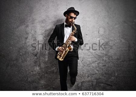 Młody człowiek saksofon grać etapie kolorowy 3d Zdjęcia stock © orla