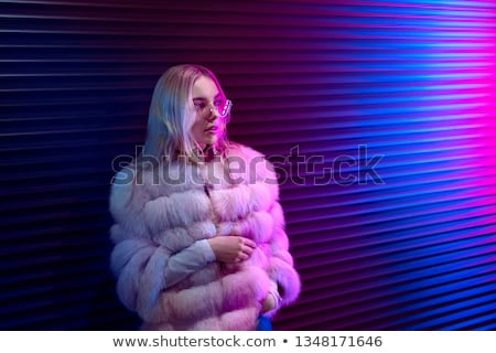 attractive young lady standing outdoors at night stock photo © deandrobot
