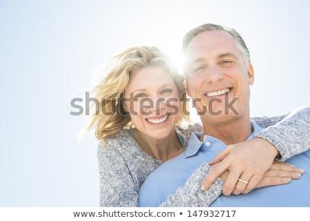 Retrato sonriendo Pareja pie cielo azul Foto stock © wavebreak_media