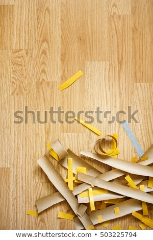 Paper cutting on the floor, top view, selective focus Stock photo © dariazu