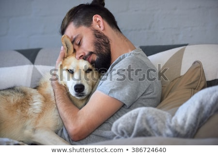 Dog and man cuddling Stock photo © IS2