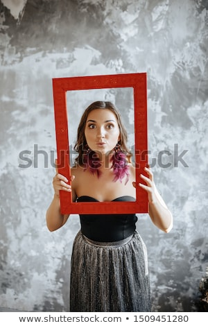 Picture of pretty woman in black dress with tablet in hands Stock photo © Traimak