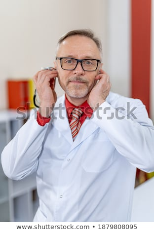 Funny M.D. with stethoscope Stock photo © Massonforstock
