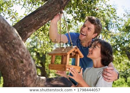Children holding birdhouses in backyard Stock photo © IS2