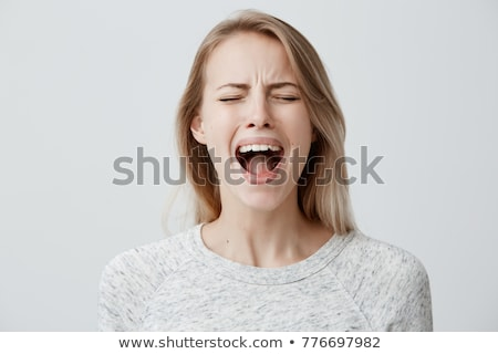 Portrait of an angry annoyed woman screaming loud Stock photo © deandrobot