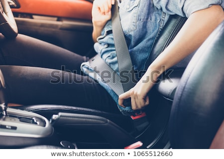 Young girl wearing car seatbelt Stock photo © IS2