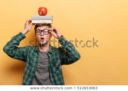boy balancing an apple on his head stock photo © is2