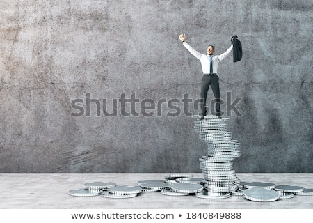 Businessman by a silver wall. Stock photo © IS2