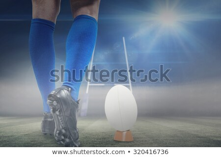 Composite image of low section of of rugby player on ball Stock photo © wavebreak_media