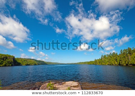 Blue skies and white clouds in the Quetico Stock photo © wildnerdpix