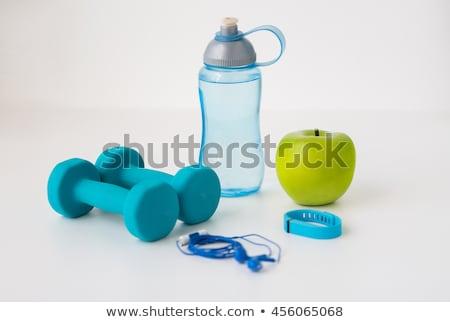 dumbbells, fitness tracker, earphones and bottle Stock photo © dolgachov