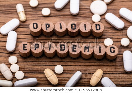 Opioid Epidemic Text On Cork With Prescription Pills Stock photo © AndreyPopov