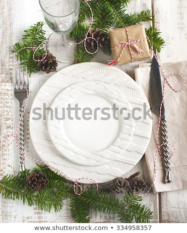 christmas table setting with gift box and fir tree stock photo © karandaev