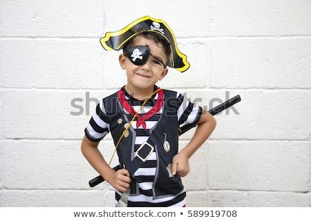 Kicsi fiú kalóz pózol fegyver izolált Stock fotó © acidgrey