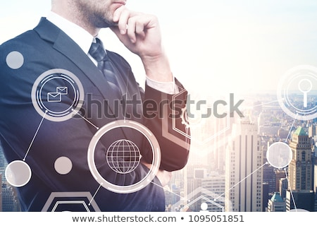 businessman looking at virtual cloud hologram Stock photo © dolgachov