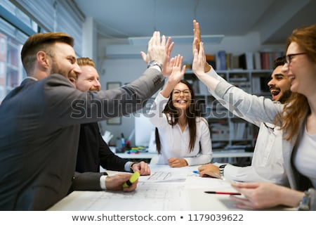 business team applauding to woman at office Stock photo © dolgachov