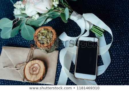 wedding bouquet with rings, wooden box for rings, smartphone Stock photo © ruslanshramko