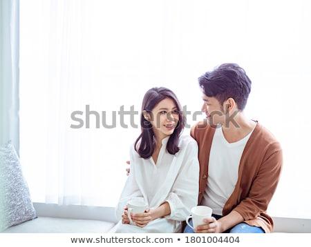 Asian zoete vergadering sofa vrouw Stockfoto © yongtick