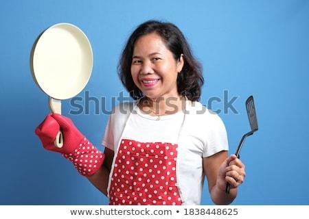 Derűs szakács szakács visel egyenruha mutat Stock fotó © deandrobot
