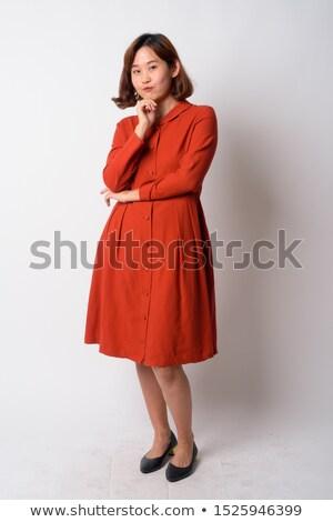 Portré töprengő ázsiai nő ruha áll Stock fotó © deandrobot