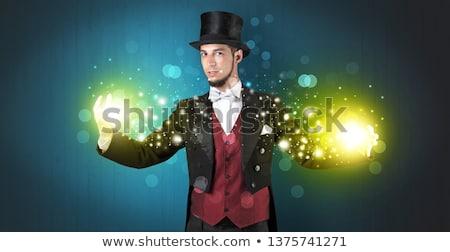 Illusionist holding superpower on his hand Stock photo © ra2studio