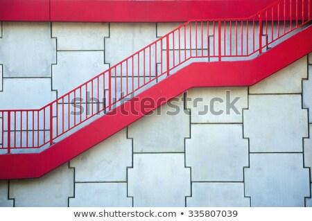 Eski merdiven kırmızı duvar inşaat Stok fotoğraf © bogumil