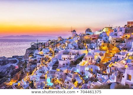 Szélmalom naplemente Santorini puha narancs város Stock fotó © neirfy