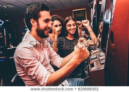 Happy Gambler with Slot Machine Casino Player Stock photo © robuart