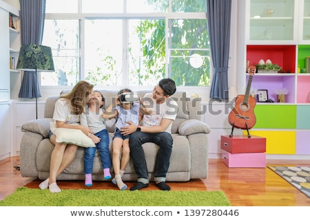 mother and daughter in vr glasses playing at home Stock photo © dolgachov