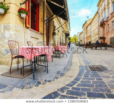 narrow stone restaurant street in old mediterranean town of korc stock photo © xbrchx