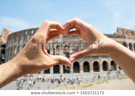 Couple Making Heart Shape In Front Of Colosseum Stock photo © AndreyPopov