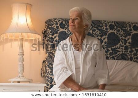 Elöl kilátás figyelmes idős nő ül Stock fotó © wavebreak_media