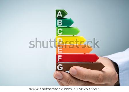 Kéz tart műanyag energiahatékonyság grafikon közelkép Stock fotó © AndreyPopov