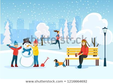 Children Sculpting Snowman in Winter City Park Stock photo © robuart