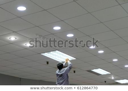 Homme électricien lumière silhouette sous-sol Photo stock © AndreyPopov