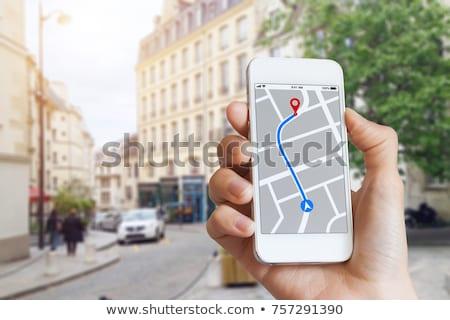 человек GPS навигация карта мобильного телефона Сток-фото © AndreyPopov