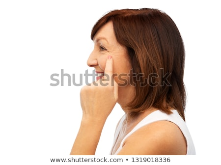 Profiel senior vrouw wijzend oog rimpels Stockfoto © dolgachov