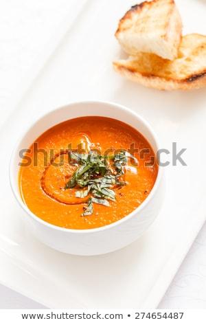 Puree soup with bread on white table Stock photo © galitskaya
