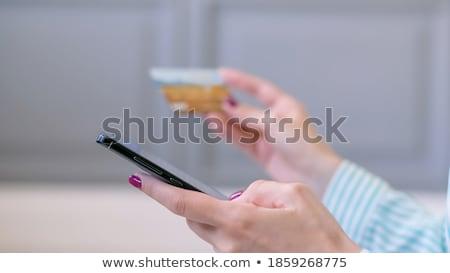 close up of woman using black interactive panel Stock photo © dolgachov