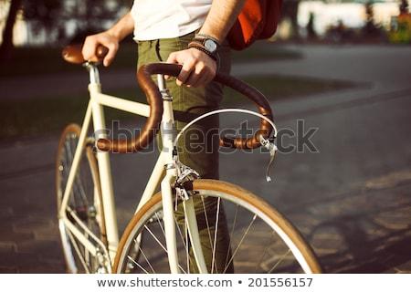 Adam binicilik sabit dişli bisiklet Stok fotoğraf © dolgachov