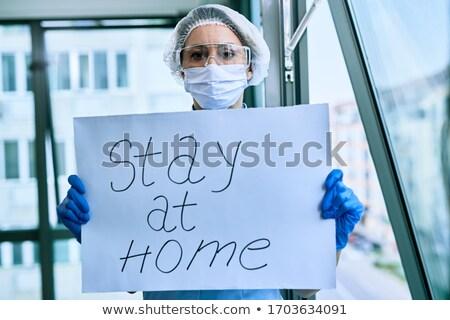 Orvosok tart figyelmeztetés feliratok koronavírus vírus Stock fotó © lovleah