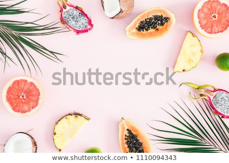 Flat lay of exotic fruits on pink background. Stock photo © Illia